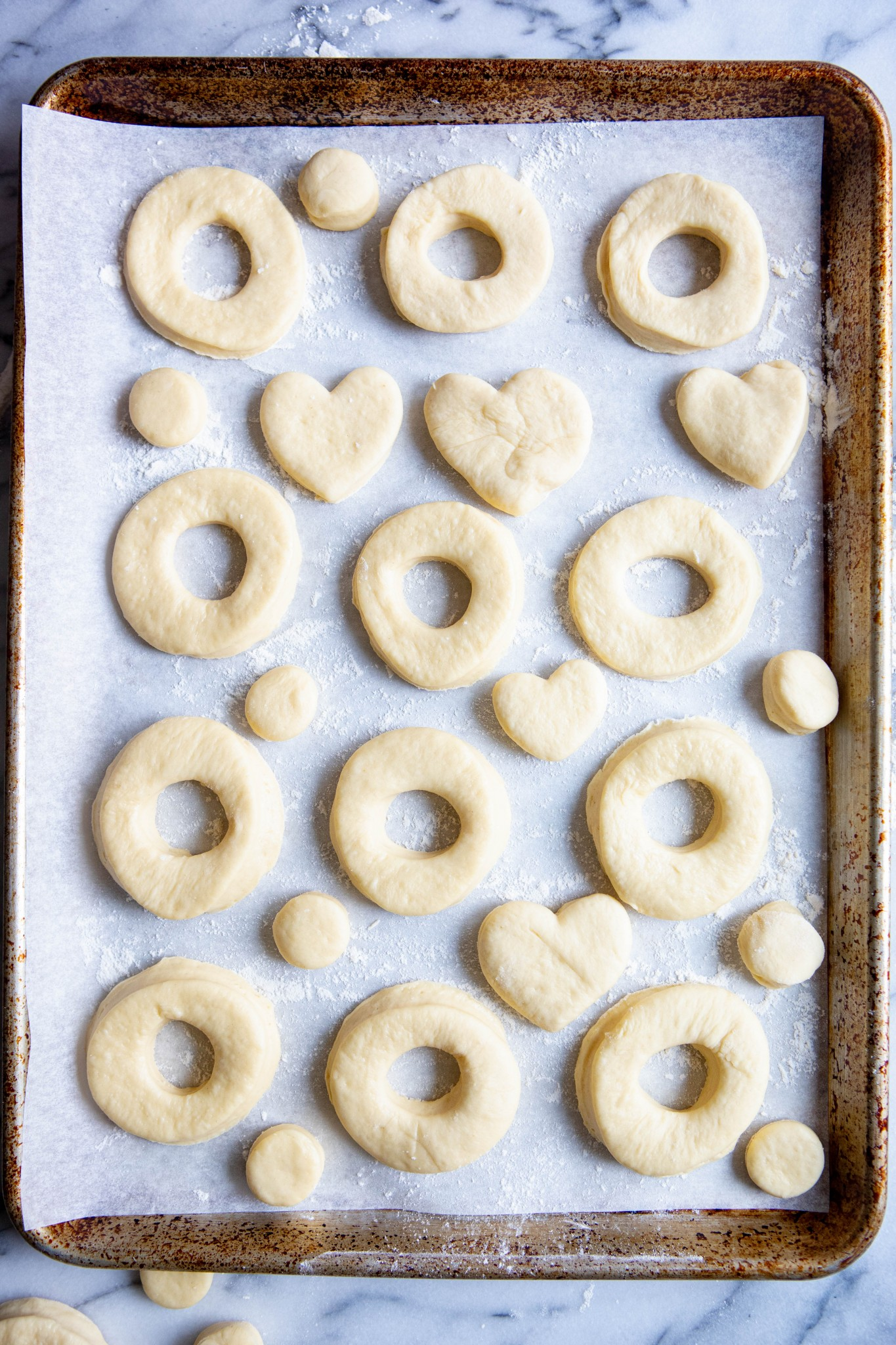 cut out donuts on a cookie sheet lined with parchment paper