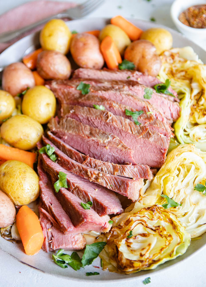 homemade corned beef with braised cabbage and potatoes on a platter